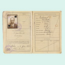 Open passport with photo, stamps and handwritten entries