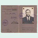 Two pages of an open identification document with handwritten entries, stamps and a passport photo of a young man in a suit.