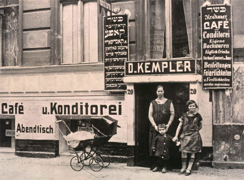 Woman with two children in front of shop entrance