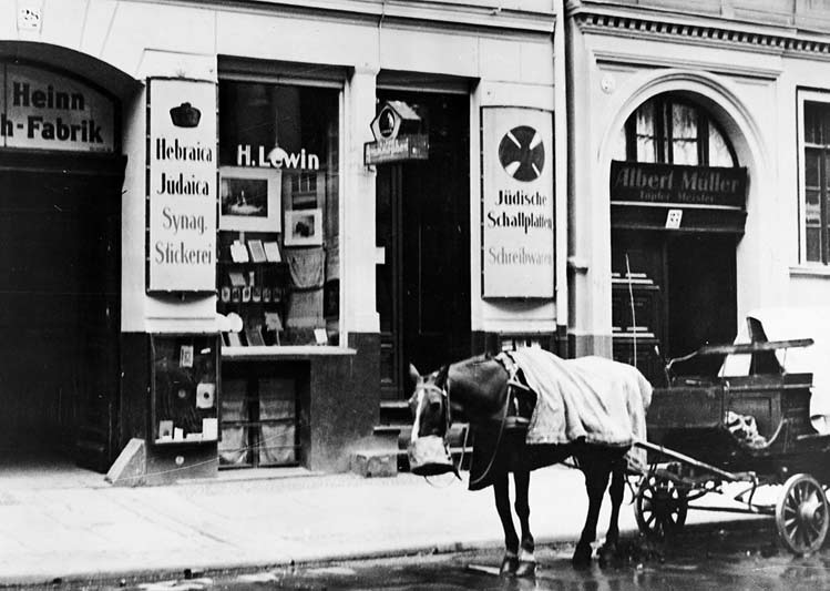 Historical photo: exterior view of shop with carriage in front