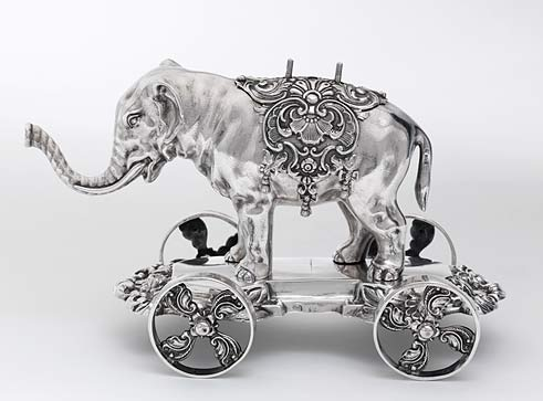 Silver-colored elephant on wheels