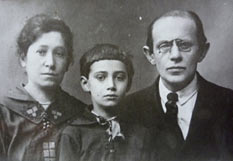 Black-and-white photo of the family: mother, son, and father