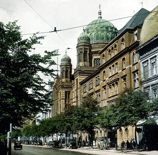 Colored historical photo with street view and synagogue