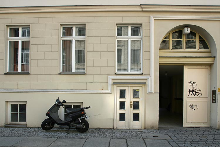 Facade with scooter in the foreground