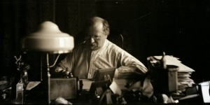 Constantin Brunner sitting at his desk