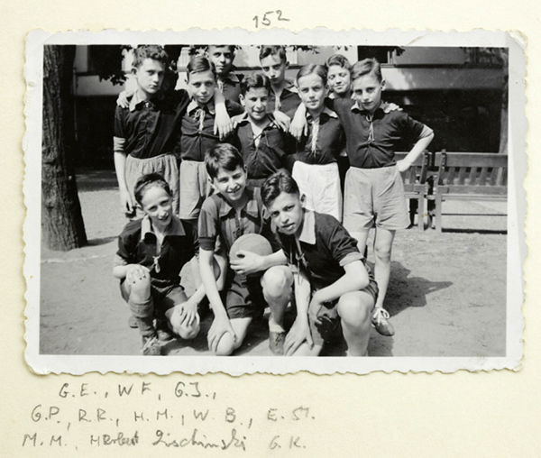 Young football players pose before the game