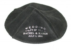 "Black kippah with the inscription ""Wedding of Rachel & Karen Juli 1, 1995"""