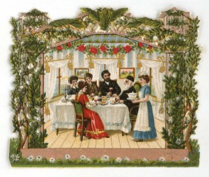 picture of a family sitting in the sukkah