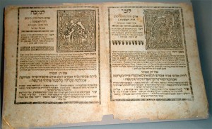 Page with Hebrew letters and to pictures of amulets
