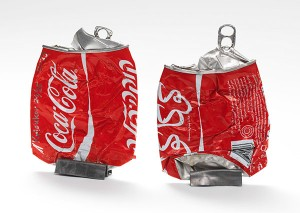 Crushed Coca-cola cans with Hebrew and Arabic letters
