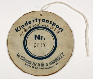 "Number tag ""Kindertransport Nr. 8434 ot the Relief Association of Jews in Germany"""