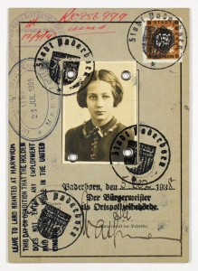 A passport with a photo and several stamps