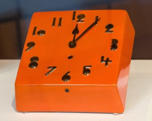 Orange glazed clock with black numerals