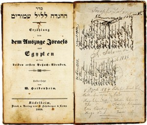 Cover of a Hebrew-German edition of the Haggadah with handwritten entries on the inside flaps