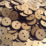 a heap of wooden buttons