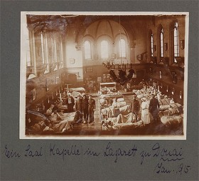 black and white photograph of a hospital room with several people set up in a church chapel