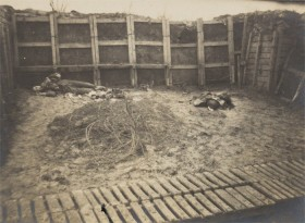 black and white photograph of a trench with a dead soldier