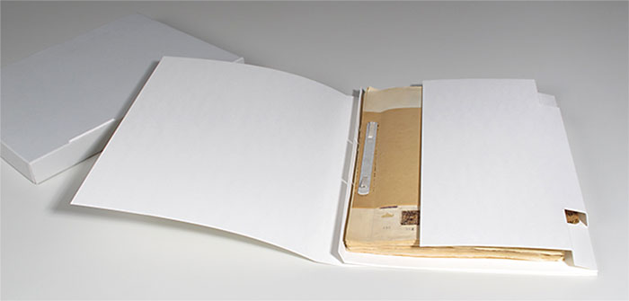 The restored stamp album in its inner packaging, with the archive box to its left