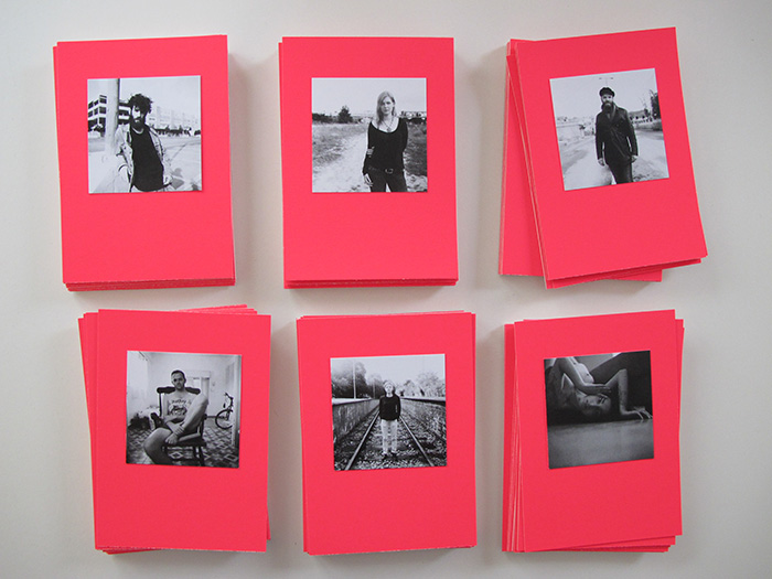 Black and white photographs on pink cards