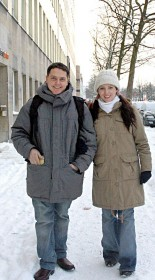 color photograph of a young couple standing in the snow