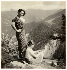 A woman and a young girl in the mountains