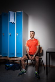 Portrait of a man in sports wear in a locker room