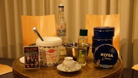 Table with different objects: Nivea Creme, Raki, yogurt, a mocha cup