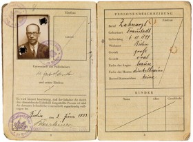 Open passport with a photo of a man with glasses on the left side