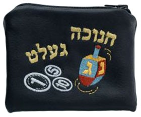 A black purse with Hebrew letters, coins and a dreidel stiched on it