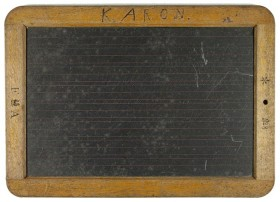 "A blackboard with wooden frame with the inscription ""K. Aron"""