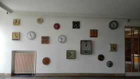 The station's entryway with different clocks on the wall