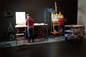 Two conservators in the exhibition