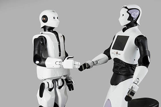 Two humanoide robots greet each other
