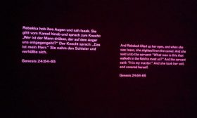 Quote from the Torah, projected onto the wall, Genesis 24, 64-65
