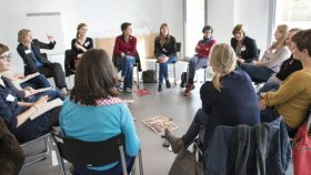 Photo of a discussion group sitting in a circle.