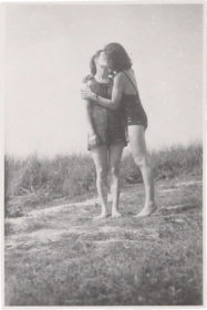 Two women kissing each other
