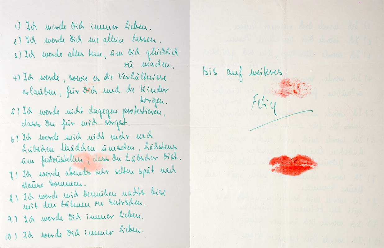 Handwritten in green ink, impressions of a kiss mouth on the back, which also shine through on the front side
