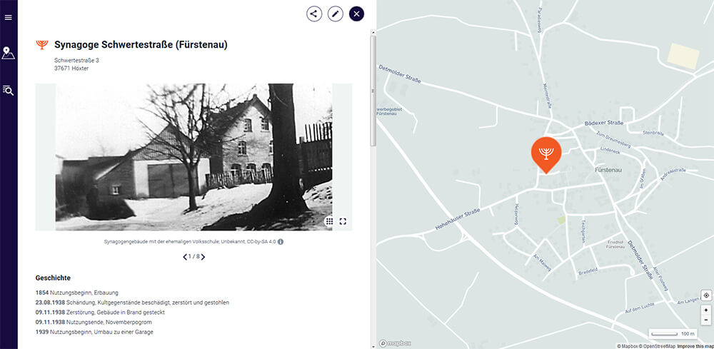 Screenshot showing an out-of-focus historical photo of the building on the left and a map with the site marked on the right
