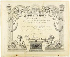 Eine handschriftliche Urkunde auf einem Blatt mit Säulenornamenten mit hebräischen Buchstaben darauf.