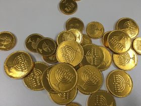 A pile of chocolate coins with Hanukkah menorahs on them