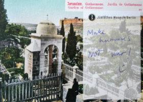 """Postkarte mit der Aufschrift """"Make hummus not war"""""""