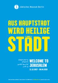 Plakat mit der Aufschrift »Aus Hauptstadt wird heilige Stadt«, wobei das letzte a einen Heiligenschein trägt