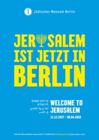 Plakat mit der Aufschrift »Jerusalem ist jetzt in Berlin«, wobei das u durch eine Menora ersetzt ist