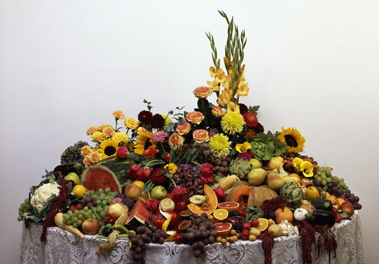 Table with fruit, vegetables and flowers