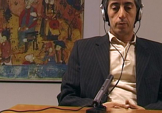 Man with headphones in front of a microphone