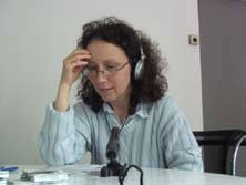Woman with headphones in front of a microphone