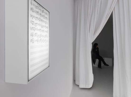 light box on the wall with music notes, view of a room behind a curtain