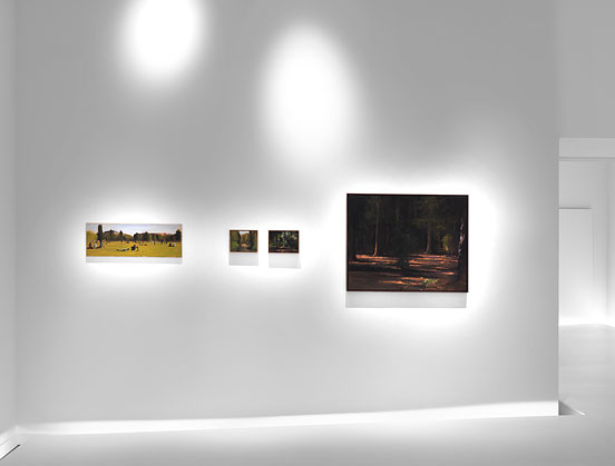 view of a wall with four works of art