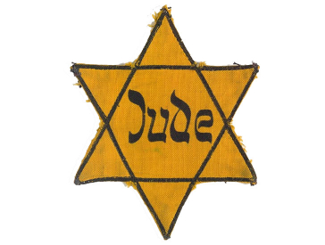 Yellow star with the word Jude (Jew) on it