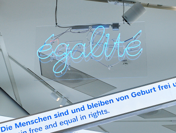 "Exhibition view showing the neon lettering ""égalité""."